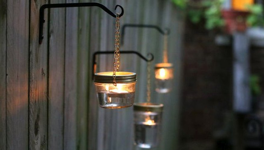 Transform mismatched mason jars into simple fence-mounted outdoor lighting.