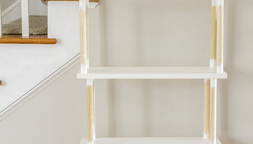 Paint everything on the shelving unit white except for the dowel rods.
