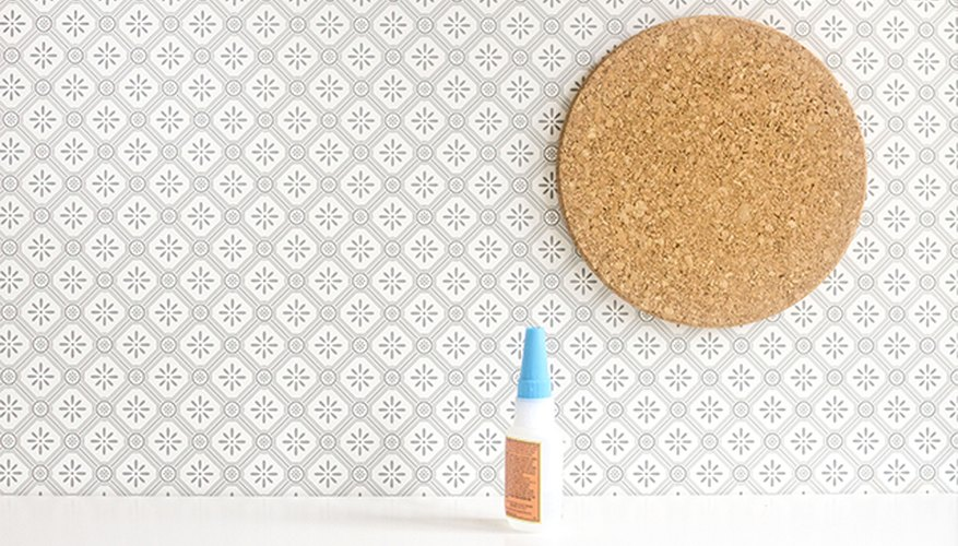 Use super hold glue to attach the backer board and one round IKEA cork trivet to the desktop.