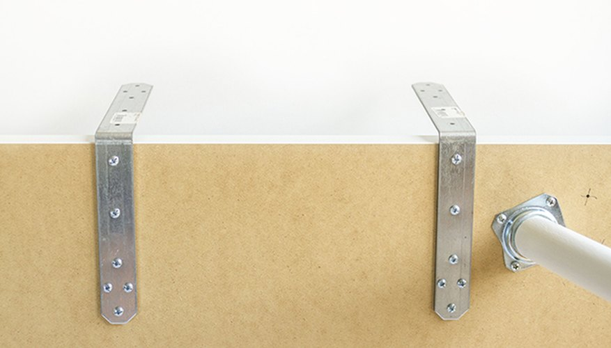 Flip the desktop over and screw all three corner braces into place.