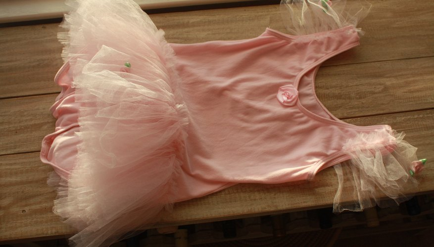 How to make a tutu stiff our pastimes a ballerina tutu usually consists of a snug bodice and several layers of tulle fabric gathered tightly in a frilly dance skirt the stiffness of the tulle ccuart Choice Image