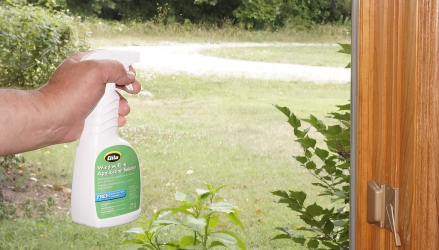 Clean the window again with film application solution.