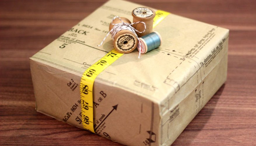 Decorate the box with measuring tape and spools