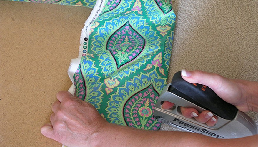 Tack the fabric in place on each of the four sides.