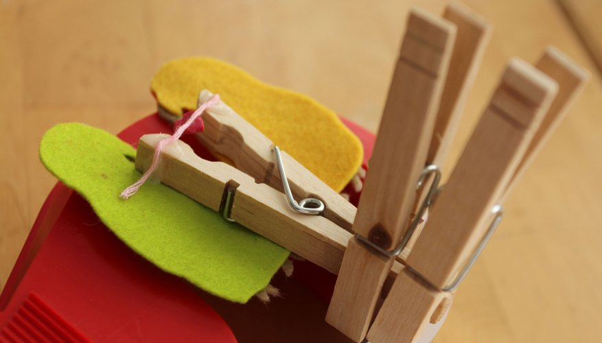 Pinch the clothespin open, using additional clothespins.