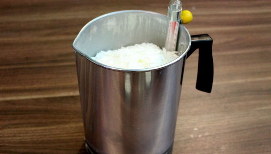 Place wax flakes in the pouring pitcher