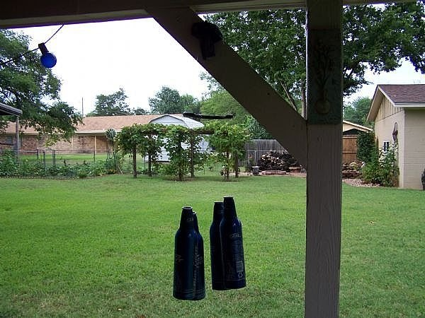 How to make a beer bottle wind chime ehow for How to cut a beer bottle at home