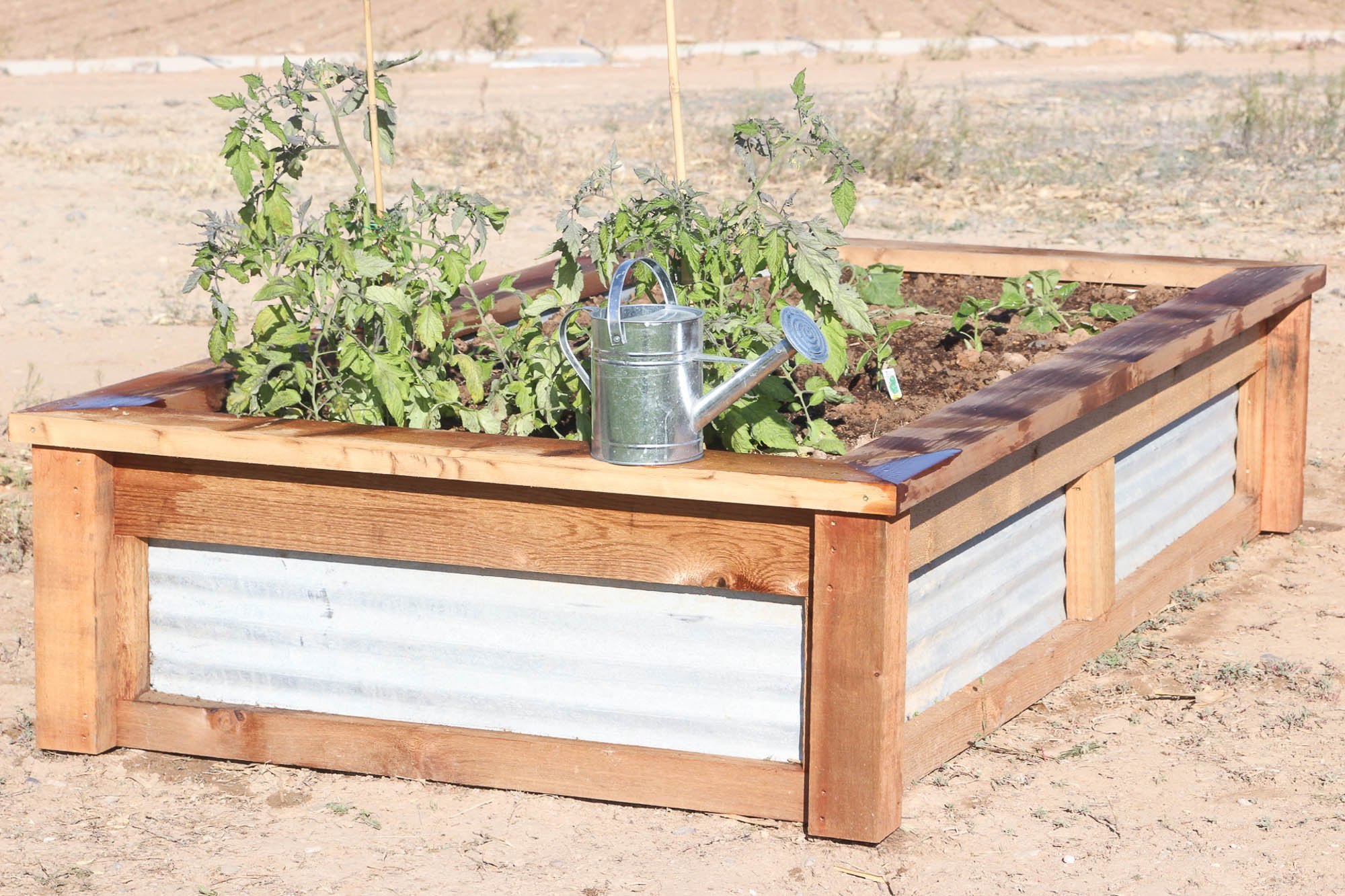 How to build raised garden beds with corrugated metal ehow for Corrugated metal raised garden beds