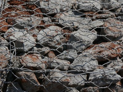 Gabions may contain basic rock or unique patterns and layers.
