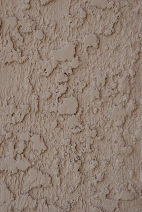 How To Paint Rough Stucco With A Roller Ehow
