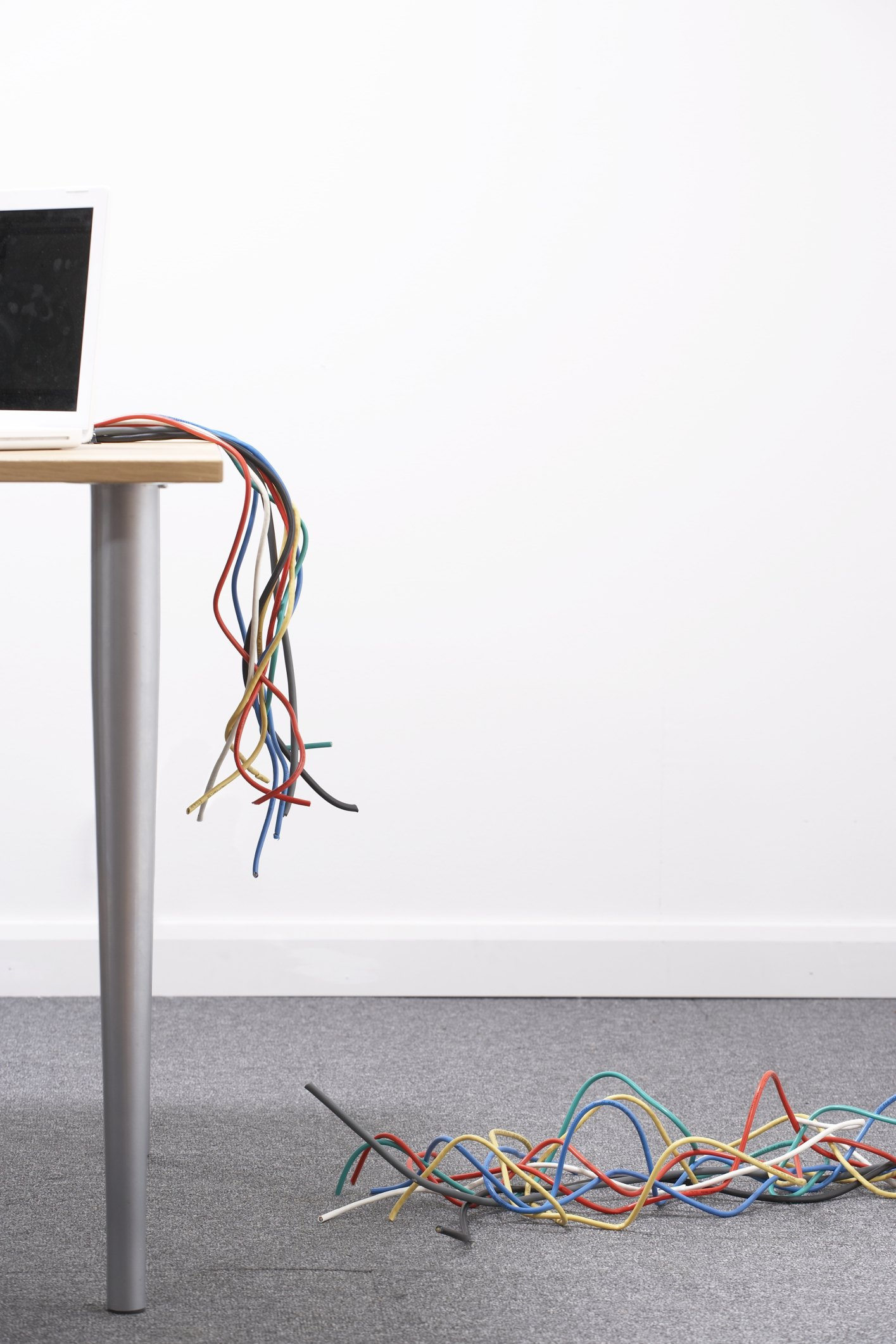 How to Handle Cords for a Desk in the Middle of a Room | eHow